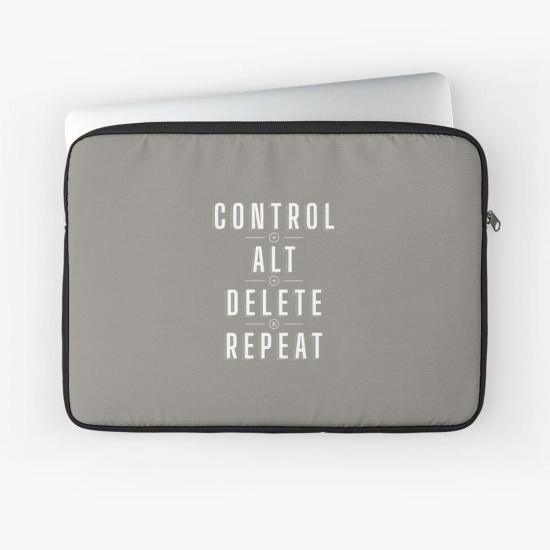 Control alt delete repeat laptop sleeve - design by Piotr Kowalczyk